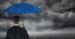 Back of business man with umbrella against storm clouds with rain. Digital composite of Back of business man with umbrella against storm clouds with rain royalty free illustration