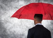 Back of business man with umbrella against white background and grunge overlay. Digital composite of Back of business man with umbrella against white background Stock Photography