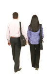 Back of business people walking. Back of two business people walking  and holding suitcases isolated on white background Stock Images