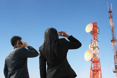 Back of business pople on phone and antenna Stock Images