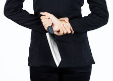 Back of business woman with aknife Royalty Free Stock Photo