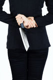 Back of business woman with aknife Royalty Free Stock Images