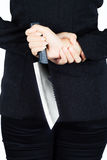 Back of business woman with a knife Royalty Free Stock Images