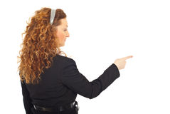 Back of business woman pointing to side Stock Photos