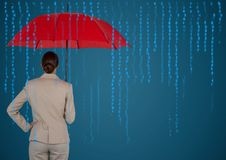 Back of business woman with umbrella against blue background and blue code Royalty Free Stock Image