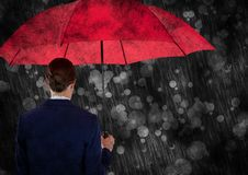 Back of business woman with umbrella against bokeh with grunge overlay. Digital composite of Back of business woman with umbrella against bokeh with grunge Royalty Free Stock Photography