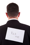 Back of businessman, with kick me written in paper Royalty Free Stock Photography