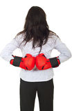 Back of businesswoman hiding gloves Royalty Free Stock Images