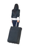 Back of businesswoman with luggage. Back of businesswoman or stewardess going in a travel and carry luggage isolated on white background Stock Photos