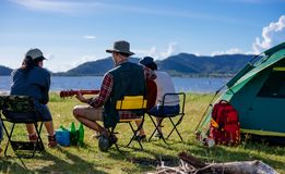Back camping camp in nature happy friends group playing guitar i. N summer at nature forest stock photography