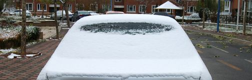 Back of the car. Covered by snow, close up Royalty Free Stock Photography