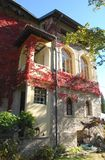 Back of the castle with beautiful red ivy in the village of Strassoldo Friuli (Italy) Royalty Free Stock Images