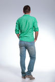 Back of a casual man with hands in pockets Stock Photos