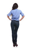 Back of a casual woman with hands on hips Royalty Free Stock Image