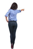 Back of a casual woman pointing away Royalty Free Stock Images
