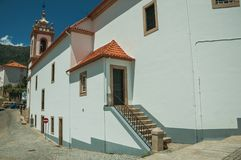 Back of the church of Santa Maria and door. Manteigas, Portugal - July 14, 2018. Back of the church of Santa Maria with staircase leading to a door at Manteigas royalty free stock images