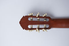Back of classic guitar on white background Stock Images