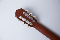 Back of classic guitar on white background Royalty Free Stock Images
