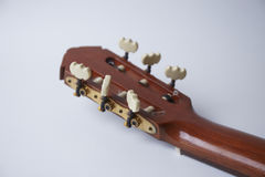 Back of classic guitar on white background Royalty Free Stock Photos