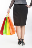 Back Closeup View of Woman Holding Shopping Color Bags Stock Photos