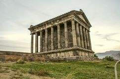 The back corner of the medieval pagan temple, built in honor of the Sun God Mithra in the village of Garni, near Yerevan. Side view of the medieval pagan temple royalty free stock photo