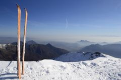 Back country ski on the top. Pair of back country ski on the top with scenic view of the italian western Alps in winter Stock Photo