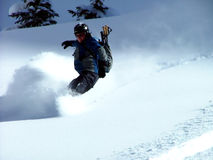 Back-Country Snowboarder. Running down hill in fresh powdered snow in Colorado Stock Photography
