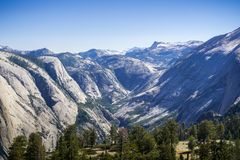 Snow capped mountains and snow melt running down in the valley in Yosemite National Park, California royalty free stock photography