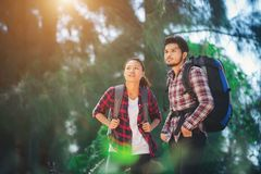 Young couple go adventure hiking together on vacation. stock photography