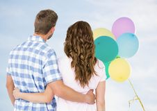 Back of couple looking at balloons Royalty Free Stock Photo