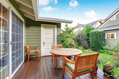 Back deck of guest house with wooden table set. View of back deck with wooden table set and nice view. Guest house exterior. Northwest, USA Royalty Free Stock Image