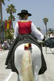 Back of decorated horse riding in opening day parade down State Street, Santa Barbara, CA, Old Spanish Days Fiesta, August 3-7, 20 Stock Photo