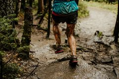 Back dirty legs woman runner stock photo