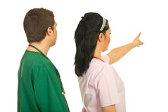 Back of doctors pointing away Stock Photo