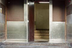 Back door or back entrance of a building with metal boardings Royalty Free Stock Photo