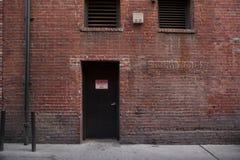 Alley Entrance backside of Brick Building Royalty Free Stock Image