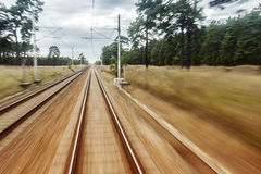 Back Door Train View. Landscape in Motion. With Train Rails royalty free stock images