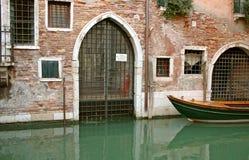Back door in Venice. Back door to Venetian house in Venice Royalty Free Stock Images
