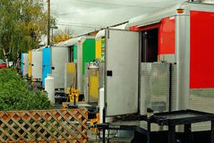 The back doors of the trailers in a food court in Portland, Oregon. Back doors wide open for ventilation in these beautiful and colorful food trailers Royalty Free Stock Image