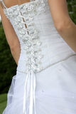 Back Dress. The back of a brides wedding dress Stock Photo