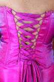 Back of Dress. The laceup part of a women's fancy party dress in hot pink Stock Photos