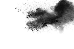 Back dust particle splash on background. Black powder explosion against white background royalty free stock images