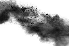 Back dust particle splash on background. Black powder explosion against white background royalty free stock photography