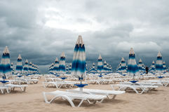 Back-end on beach. Back-end on the beach. Sunshades has been closed, the spell of fine weather has broken Stock Photos