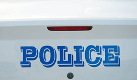 Back end of a police cruiser Royalty Free Stock Photo