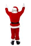 Back of excited Santa Claus Stock Images