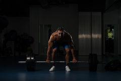 Back Exercise With Barbell In Fitness Center. Muscular Hispanic Man Doing Heavy Weight Exercise For Back With Barbell In Modern Gym Stock Images