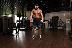 Back Exercise With Barbell In Fitness Center Stock Photos