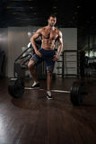 Back Exercise With Barbell In Fitness Center Royalty Free Stock Photo