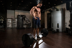 Back Exercise With Barbell In Fitness Center Royalty Free Stock Photos